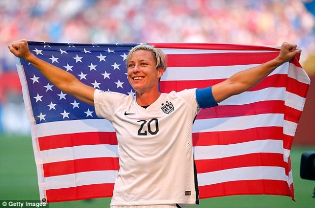 2a42f0ef00000578-0-abby_wambach_brandishes_a_star_spangled_banner_with_glee_after_c-a-39_1436157590942